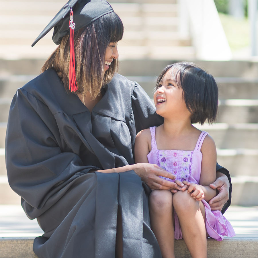 A graduate student smiling with a girl